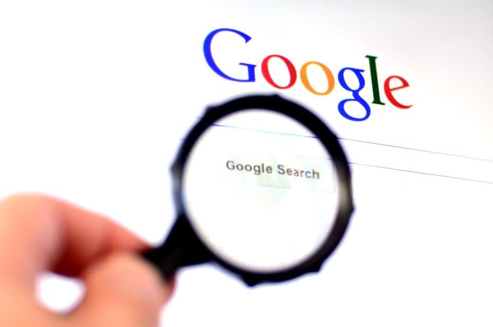 Magnifying glass looking at Google search screen